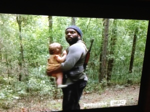 Somebody get that man an Ergo baby carrier!