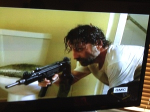 As Rick grabs the man's gun and prepares to go out the bathroom window, he goes back to crack the door of the bathroom open, to set a