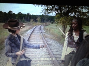 Carl shares the prize, the last stale-ass Big Kat bar...sweet boy loves him some Michonne