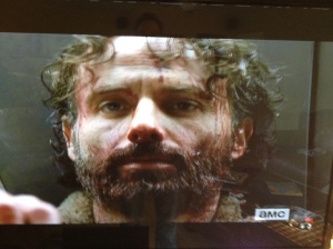 One look at Rick's face, here, and we know some shit went down...
