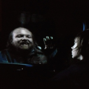 Meanwhile, at the car, a nightmare comes a knockin' for poor Carl...