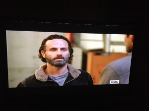 Rick ain't buying it...and Michonne, Daryl aren't looking too convinced either.