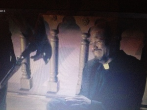 It looks like Father Gabriel has def seen, and done, some dark things to survive.