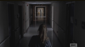 As she peers down the hallway, looking for a point of exit, Beth sees a tall young man, far down the hallway, mopping.