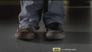 Beth grabs Gorman's gun, heads down the hallway from the office.  She looks down and sees blood on her Chuck Taylors...I hate when that happens!