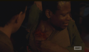 Bob pulls his shirt away, showing Sasha, and the gang, the walker bite on his shoulder.