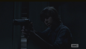 carl raises gun in gabriels office