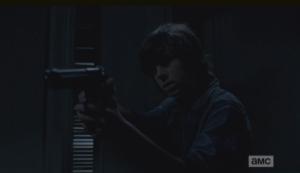 carl raises gun in gabriels office