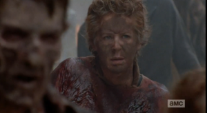 Carol takes in the scene, hidden among the walkers.