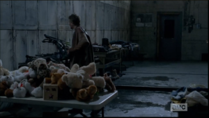 carol picks up daryls crossbow