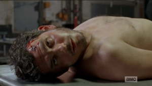 Before going to cut Daryl, Glenn and Bob loose, Rick sees Alex's body laid out on the metal processing table.  Way to keep it in the family, Gareth, you sick bastard.
