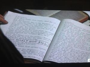 Carol finds Gabriel's office, with a journal book containing handwritten scripture...THOU SHALT NOT KILL.