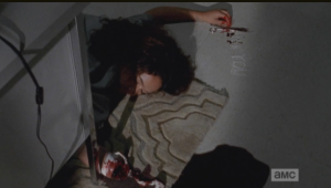 ...poor Joan's body, after cutting her own wrist and arm, and bleeding out.  So sad, but so kind of badass too...Joan really doesn't seem to give a fuck about becoming a walker...she's like, bring it, bitch, and I'll bring the mayhem to this bunk-ass debt castle.