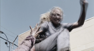Upon seeing a walker woman on the ground, hissing and reaching up for her, Beth does the Walker Stomp on the walker's head...