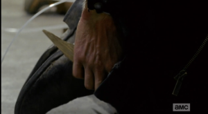 Rick pulls his shiv out of his boot, grips it, and waits.