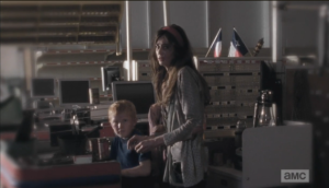 Silently, fearfully, Abraham's wife, Ellen, and their son (who looks like a mini Abraham) and daugher come out from under the desk where they were crouched, hiding...they look at Abraham as if they are terrified of him.