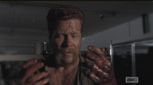 Abraham looks down at his bloody hands, whispers,