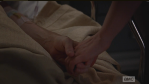 Beth takes Carol's hand.