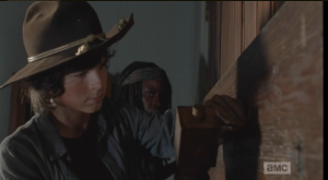 Carl and Michonne board up the church, sealing themselves, Judith, and Father Gabriel in, safe and tight...in theory.