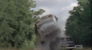 ...then, the front driver's side wheel flips up over an abandoned car in the road, sending the bus flying and landing hard, screeching and smoking, on its right side...