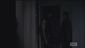 Daryl and Carol silently register the import of this awful sight. (Cried every time I watched this scene...this shit is why I drink, people.)