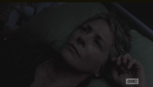 Carol turns and heads back to the little room with the bunk beds, troubled, and finally gets some sleep.