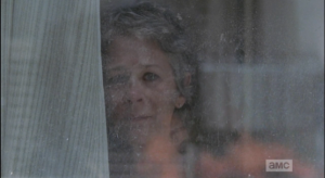 The next morning, Carol awakes, sees smoke billowing outside the window.  She goes to the window, and what she sees brings her to tears...