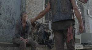 They stop to rest, and Carol is noticably hurting, although she tries to play it off. Daryl blames himself, and Carol jokes,
