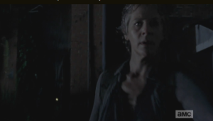 Carol stands watch, rekilling walkers as they approach the two, as Daryl jimmies the lock of the back gate, leading into the rear entrance of the law firm.