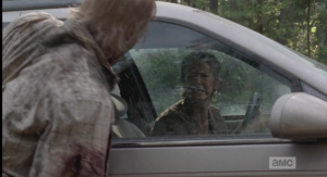 Carol's much needed cry is soon rudely interrupted by Snoopy Walker, who snarls and flails at the car window, trying to get to her.  She screams at Snoopy Walker to leave her alone, before peeling off down the road.
