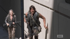 Daryl and Carol keep close to the sides of the buildings, running quietly through the streets of Atlanta.  Hug the shadows, hug the shadows, Daryl and Carol!