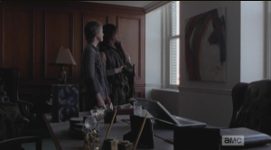 As they look at the painting, Daryl says that it looks like
