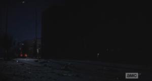Daryl and Carol pull up behind black car