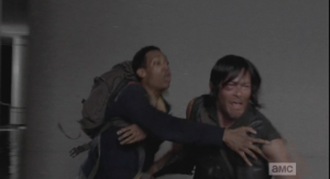 Daryl, anguished, tries to run to her, but Noah holds him back, telling him that they can help her, that they have the power, and the equipment, to help her, and if Daryl runs out there, he will have to fight them, kill them, and then she won't be helped, and does he want that?