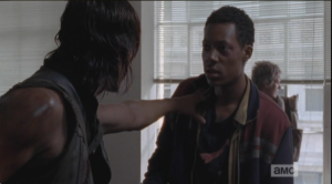 Daryl grabs him, asks him if there was a blond girl there. Noah's eyes widen