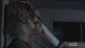 Daryl does the walker a solid machete rekill, shutting it the hell up.