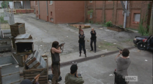 Looking majorly fine, Deputy Rick Grimes talks the cops down, telling them weapons down, hands up,