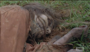 Eugene forms a gob of spit in his mouth, and  unleashes his spit upon his first ever walker kill.
