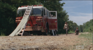Her voice breaking slightly, Maggie slams the fire truck door shut, and walks away, telling Abraham that,