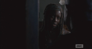 Michonne replies that she doesn't want anything from him...she was just making sure he was ok.  Gabriel thanks her, closes the door...