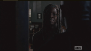 Michonne asks Gabriel how he's doing...tells him that the things they do, it's worth it...he gets a little testy, replies,