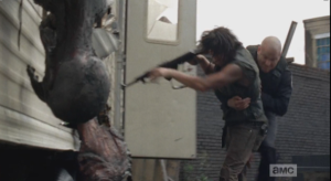 Oooff! Officer Baldy tackles Daryl...