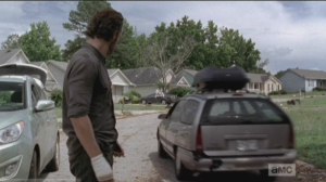 Rick watches Carol drive off