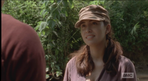 Disarmed, Rosita takes just a moment before smiling, agreeing,