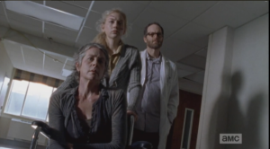 We see Beth wheeling Carol down the hall in a wheelchair, with Doc Edwards behind them.