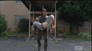 The image that has seared itself into the hearts of all WD fans worldwide...Daryl carrying Beth's body. So heartbreaking, the worst ever.