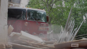 ...a perfectly timed fire truck smashes through, barring the doors and saving the day!