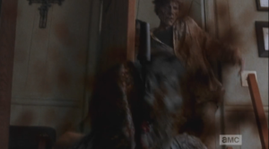 ...and Gabriel's machete makes its first kill, as Machete Walker falls right into the sharp blade, slicing her head in two. (Bravo, Nicotero & Co.!)