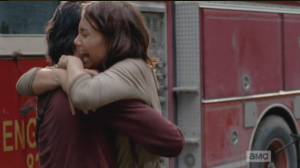 Maggie, overjoyed at hearing this news, grabs up Glenn in a hug, while Tara says,