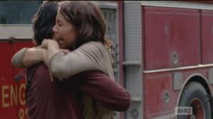 Maggie, overjoyed at hearing this news, grabs up Glenn in a hug, while Tara says,
